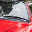 Handsome mdriving red convertible — Stock Photo #31464441