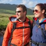 Couple wearing rain jackets and sunglasses admiring the scenery — Stock Photo