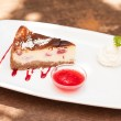 Cheesecake with chantilly cream and coulis — Stock Photo