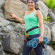 Attractive female rock climber smiling at camera — Stock Photo