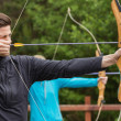 Stock Photo: Handsome mpracticing archery