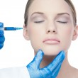 Attractive young model having botox injection on the cheek — Stock Photo