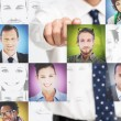 Businessman pointing at digital interface presenting profile pictures — Stock Photo