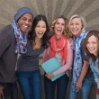 Fashionable students in a row smiling — Stock Photo