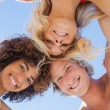 Low angle view of attractive friends on beach — Stock Photo #31465407