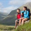 Stock Photo: Couple taking break after hiking uphill