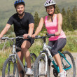 Happy couple on a bike ride — Stock Photo