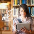 Pretty student using futuristic interface to learn about science from digital tablet — Stock Photo