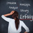 Woman having a brainstorm in german — Foto Stock
