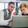 Business people working together on laptop — Stock Photo