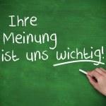 Hand writing Ihre meinung ist uns wichtig — Stock Photo
