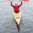 Happy man in a kayak cheering at camera — Stock Photo #31468159
