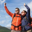 Couple on a hike cheering and smiling — Stock Photo #31469023