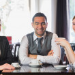 Business team having coffee together — Stock Photo