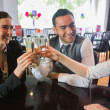Three business people toasting their success — Stock Photo