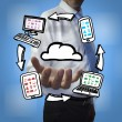 Classy businessman holding cloud computing drawings — Stock Photo