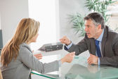 Two angry co workers arguing in an office — Stock Photo