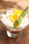 Close up on a delicious lemon sorbet with mint leaf garnish — Stock Photo