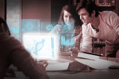 Focused students analysing dna on digital interface — Stock Photo