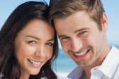 Close up view of couple smiling at camera — Stock Photo