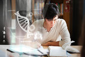 Focused college student analysing dna on digital interface — Stock Photo