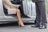 Businesswoman getting off classy cabriolet — Stock Photo
