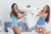 Friends having pillow fight — Stock Photo