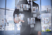 Stylish businessman presenting coworkers pictures — Stock Photo