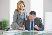 Attentive businesswoman explaining figures to a businessman — Stock Photo