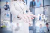 Classy businesswoman presenting coworkers pictures — Stock Photo