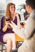 Smiling woman having glass of wine with her boyfriend — Stock Photo