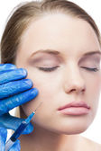Content cute model having botox injection on the cheek — Stock Photo