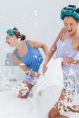 Girls having pillow fight — Stock Photo
