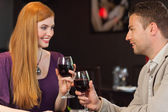Handsome man having glass of wine with his gorgeous girlfriend — Stock Photo