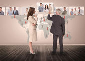 Business people selecting digital interface together — Stock Photo