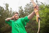 Concentrating man practicing archery — Stock Photo