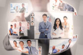 Concentrated businessman selecting a picture — Stock Photo