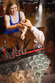 Attractive woman being served a flute of champagne — Stock Photo
