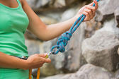 Female rock climber adjusting harness — Stock Photo