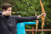 Handsome man practicing archery — Stock Photo