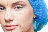 Close up on pretty young patient with dotted lines on the face — Stock Photo