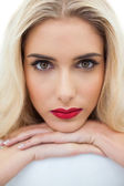 Close up of a serious blonde model looking at camera — Stock Photo