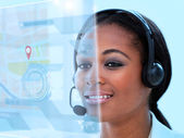 Beautiful call center worker using futuristic holographic interface — Stock Photo