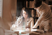 Focused college students analysing dna on digital interface — Stock Photo
