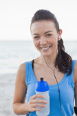Smiling woman holding her bottle — Stock Photo