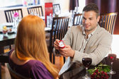 Handsome man proposing marriage to his pretty girlfriend — Stock Photo