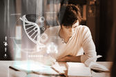 Concentrated college student analysing dna on digital interface — Stock Photo