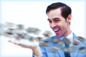 Amused businessman looking at a picture stream — Stock Photo