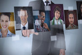 Businessman presenting profile pictures — Stock Photo
