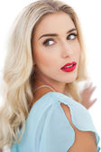 Portrait of a wondering blonde model in blue dress looking away — Stock Photo